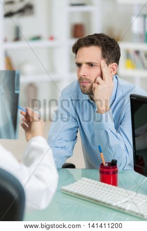 picture of despair young businessman during consultation