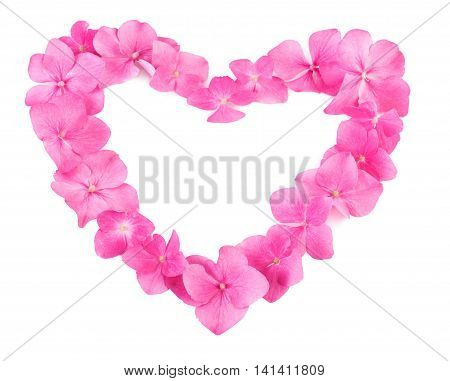 Heart made of pink flowers on white background. Natural pattern with copy space.