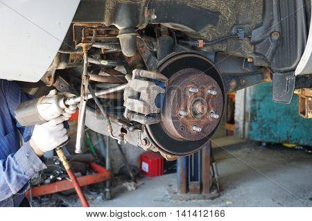 close up on wheel hub and disk brake, car repairing