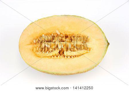 fresh cantaloupe melon cut in half on white background