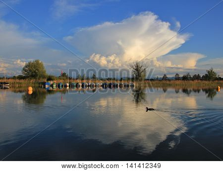 Big summer cloud mirroring in Lake Pf