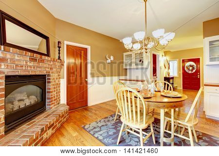American Farm House Breakfast Dining Room Area With Brick Fireplace.