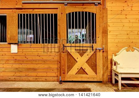 Stable Barn With Beam Ceiling And Door To A Clean Stall.