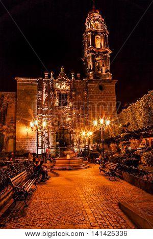 Templo de San Francisco Church Night San Miguel de Allende Mexico. San Francisco Church was created in 1778. The facade is Churrigueresque Spanish baroque style with stone statues.