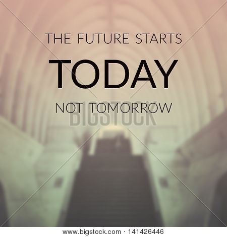Inspirational quote on blurred background ...the future starts today not tomorrow