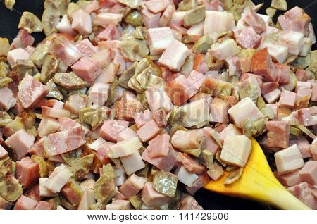 Pieces of different sliced meat products. Cooking process.