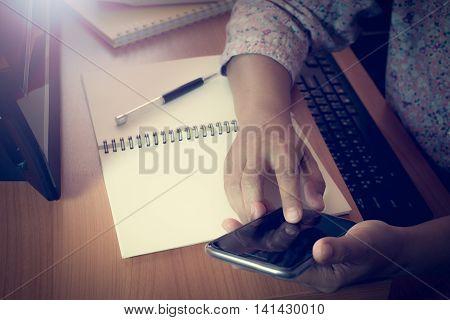 Hands Of Business Woman Touching Smart Phone Screen