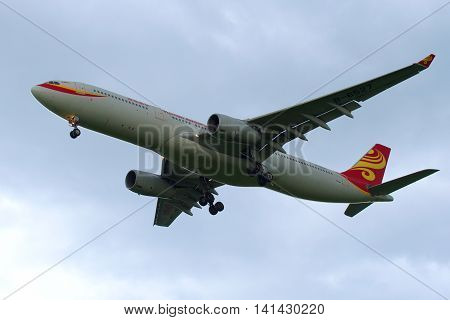SAINT PETERSBURG, RUSSIA - JULY 03, 2016: The Airbus A330-343 (B-6527) of the airline Hainan Airlines on a background cloudy sky