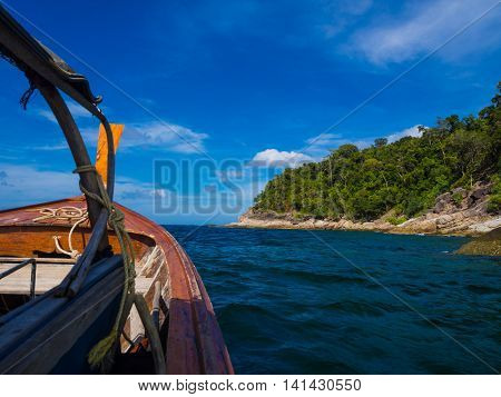 Andaman Sea With Wooden Boat And Rocky Mountain