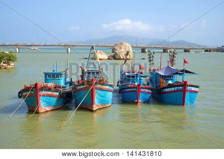 NHA TRANG, VIETNAM - DECEMBER 30, 2015: Four fishing schooners are up on the river Kai before going into the sea on a sunny day. Tourist landmark of the city Nha Trang, Vietnam