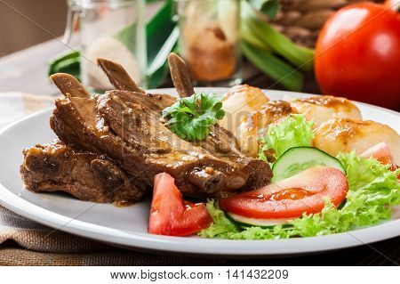 Pork Spareribs Served With Silesian Noodles And Sauce