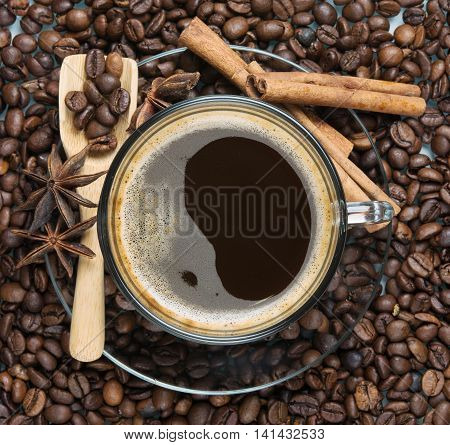 coffee with foam among the roasted beans