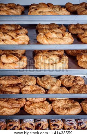 Trays with a mixture of pretzel and other pastries