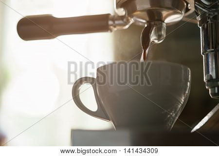 professional coffee machine preparing espresso in cappuccino cup, shallow focus