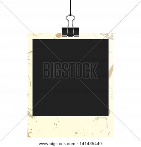 old empty dirty photo with binder clip hanging at black twine