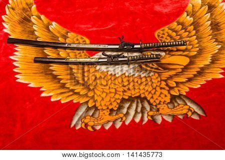 Japanese Daisho the Katana and wakisaxhi against a velvety eagle background