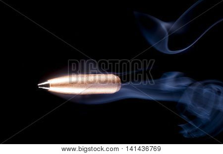 Lead bullet with copper plating and a polymer tip with smoke