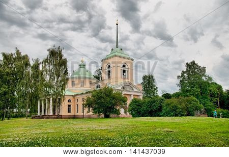 KOTKA, FINLAND - JUNE 26, 2016: The Orthodox church of St. Nicholas and Maria Purpur Sculpture by Juta Eskel in Isopuosto Park
