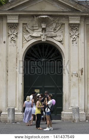 ROME ITALY - JULY 23 2016: line of tourists waiting to look through the keyhole of the Villa Magistrale dei Cavalieri di Malta