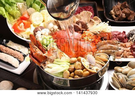 Supper crab hot pot with mushroom clams shrimps corn and vegetables in Japanese stew