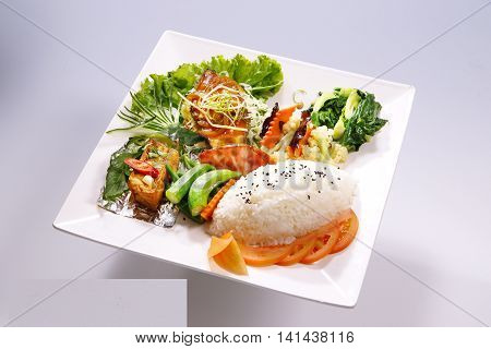 Braised pork rice braised fish meal with vegetable on white plate in white background