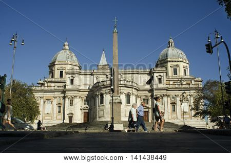 ROME ITALY - AUGUST 1 2016: Santa Maria maggiore basilica View of the back of the apse while people crossing the street