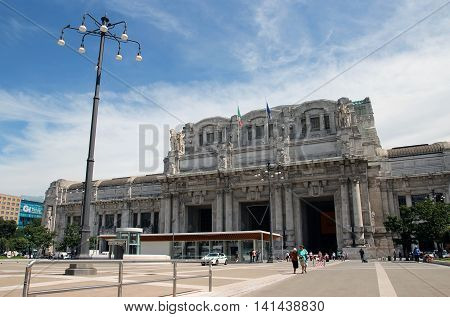 MILAN ITALY - JUNE 27 2016: people in front of the Central station Facade in Piazza Duca D Aosta