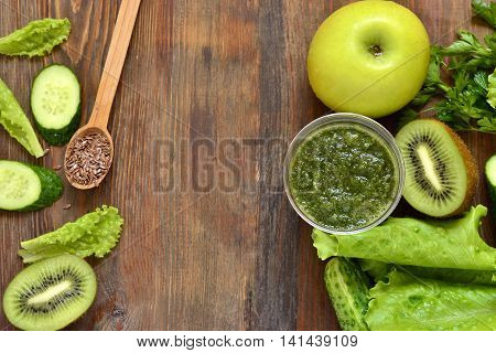 Healthy green smoothies with ingredients. Detox vegetarian diet concept, top view