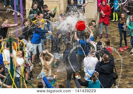 Lviv Ukraine - 2 May 2016: Celebration pouring water on Monday after Easter by the town hall. Townspeople pour water Lviv mayor.