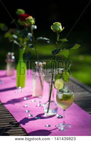 Roses with Hugo on a garden table