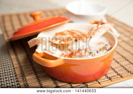 Female Crab Congee Horizontal in Chinese stew on bamboo tray