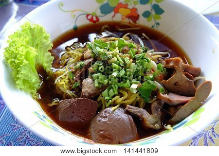 Egg noodles served with duck in a bowl