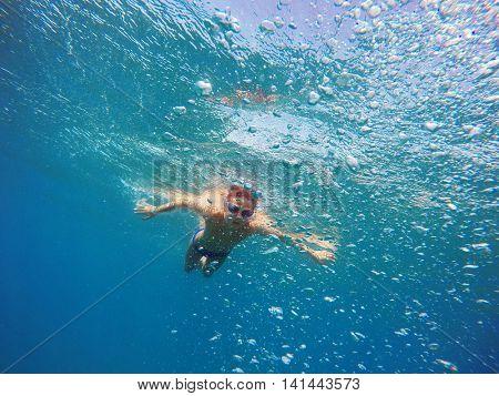 boy dives into the sea