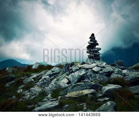 abstract Gloomy landscape with stone little man