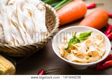 Chinese fried wonton noodle with corn carrot chili and herbs
