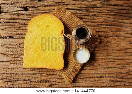 toast bread with sugar butter and small honey glass bottle