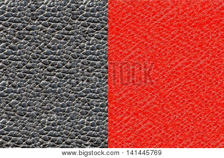 Backgrounds skin black and red. Texture natural tanned and processed pig skin leather for the manufacture of products. Raw materials for industry and leather goods.