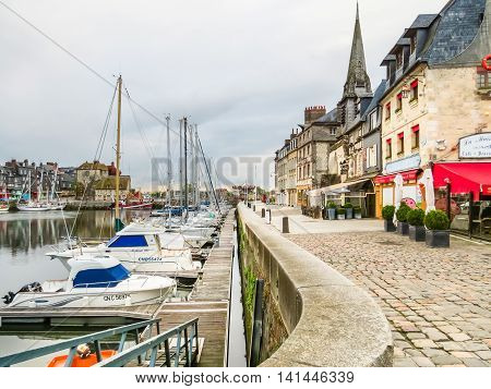 HONFLEUR, FRANCE - MAY 7 2014: Old harbor Honfleur in early morning. Normandy, France