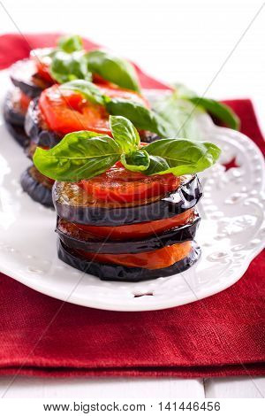 Roasted aubergine and tomato stack with basil