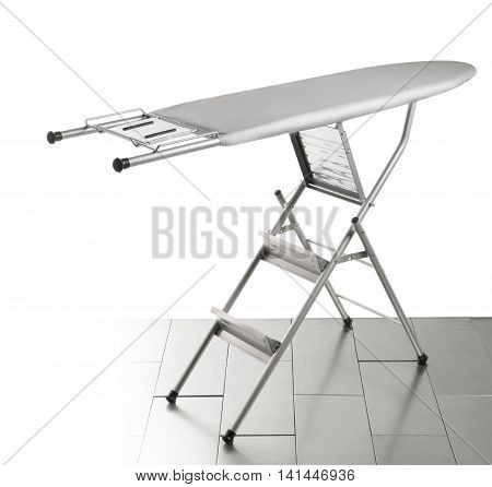 Unfolded Ironing gray board on white background