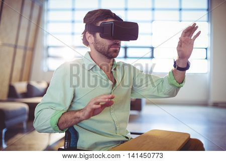 Male business executive using virtual glasses in office