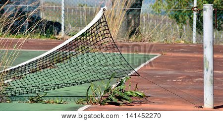 Close up of a deserted and unusable tennis court
