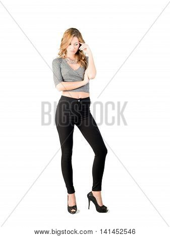 Beautiful young attractive blond fashion model posing in studio with black pant