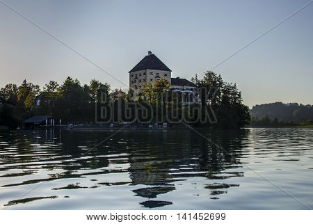 The Fuschlsee with a building of Schloss Fuschl a luxury collection resort and spa