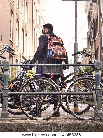 Young man with bicycle, Amsterdam city life.