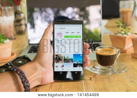 CHIANG MAI THAILAND - AUG 06 2016: A man hand holding lg g4 with instagram application. Instagram is largest and most popular photograph social networking.