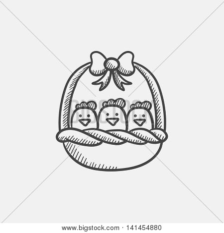 Basket full of easter chicks sketch icon for web, mobile and infographics. Hand drawn vector isolated icon.