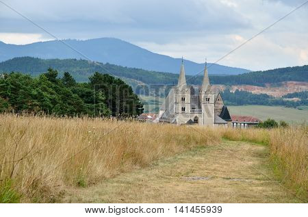 St. Martin's Cathedral with rural landscape in the background in Spisska Kapitula Slovakia.