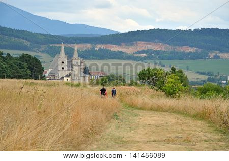 SPISSKA KAPITULA SLOVAKIA - AUGUST 18 2015: St. Martin's Cathedral with rural landscape in the background in Spisska Kapitula Slovakia.