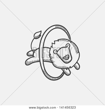 Lion jumping through ring sketch icon for web, mobile and infographics. Hand drawn vector isolated icon.